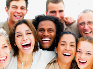 Closeup portrait of a group of people laughing